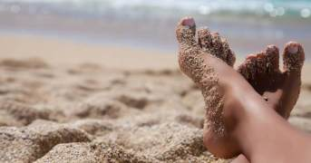 feet in the sand.jpg.600x315_q67_crop-smart