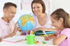 mother-children-doing-homework-home-mother-children-doing-homework-together-home-124415783
